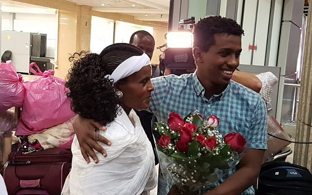 Bible Quiz participant Sintayehu Shafrao welcomes his mother Alem Wondie at Ben Gurion Airport on November 6, 2018 as she arrived with the rest of his family. (Courtesy Heart of Israel)