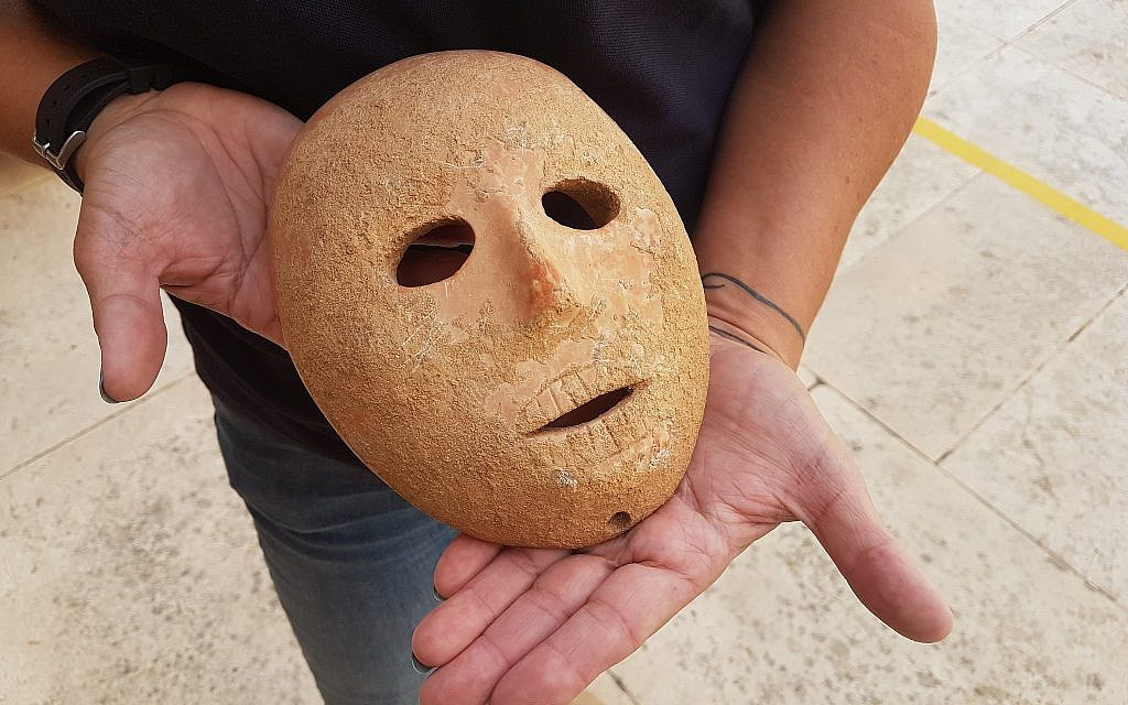 A 9,000-year-old stone mask discovered in the southern Hebron Hills area of the West Bank in early 2018. (Antiquities Theft Prevention Unit, Israel Antiquities Authority)