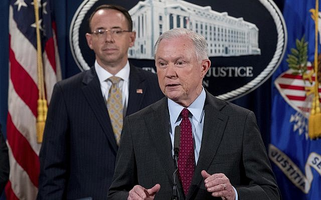 In this photo from July 20, 2017, Attorney General Jeff Sessions accompanied by Deputy Attorney General Rod Rosenstein, speaks at a news conference at the Justice Department in Washington. (AP Photo/Andrew Harnik)