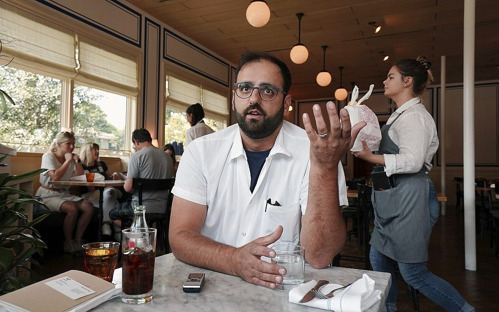 Alon Shaya speaks during an interview with the Associated Press at his restaurant Saba in New Orleans,  August 23, 2018. (Gerald Herbert/AP)