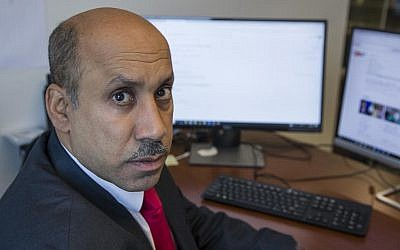 Ali AlAhmed poses for a photograph in his office Friday, Oct. 26, 2018, in Washington (AP Photo/Alex Brandon)