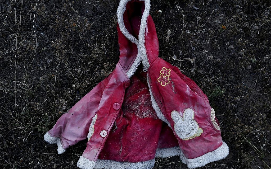 This April 15, 2018 photo shows a migrant child's jacket which was retrieved by artist Mohsen Lahzib, who tries to create beauty out of sorrow, at his space in the southern port town of Zarzis, Tunisia. (AP Photo/Nariman El-Mofty)