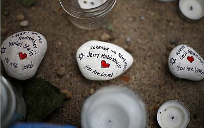 These are stones found on Wednesday, Oct. 31, 2018, part of a makeshift memorial outside the Tree of Life Synagogue to the 11 people killed during worship services Saturday Oct. 27, 2018 in Pittsburgh. (AP Photo/Gene J. Puskar)