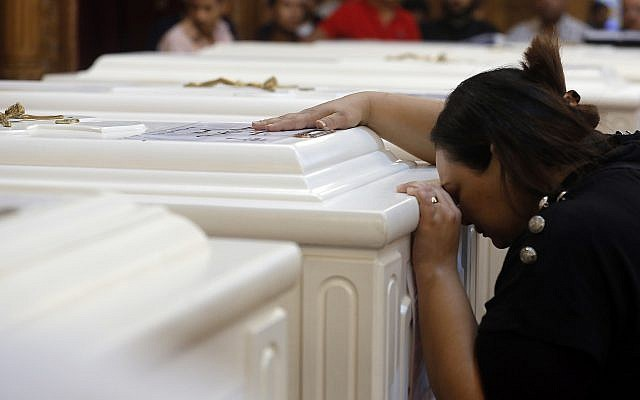 A relative of a slain Christian grieves during funeral service at Church of Great Martyr Prince Tadros, in Minya, Egypt on Nov. 3, 2018. (AP Photo/Amr Nabil)