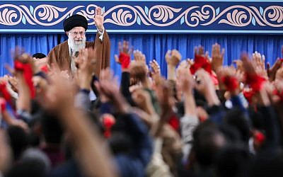 In this picture released by an official website of the office of the Iranian supreme leader, Ayatollah Ali Khamenei waves to the crowd during a meeting in Tehran, Iran, Saturday, November 3, 2018. (Office of the Iranian Supreme Leader via AP)