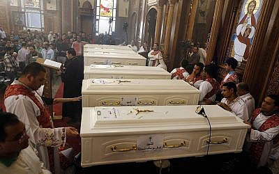 In this November 3, 2018 file photo, coffins of Coptic Christians slain in an Islamic State terror attack lie in the Church of Great Martyr Prince Tadros during their funeral service in Minya, Egypt. (AP Photo/Amr Nabil, File)