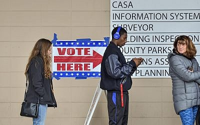 Voters line up outside of the Vigo County Annex in Terre Haute, Indiana,. on November 5, 2018, to take advantage of the final day of early voting. (Austen Leake/Tribune-Star via AP)