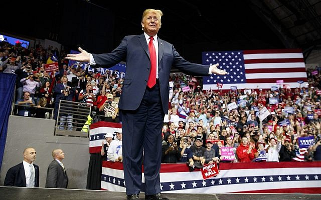 US President Donald Trump arrives for a rally at Allen County War Memorial Coliseum, November 5, 2018, in Fort Wayne, Ind. (AP Photo/Carolyn Kaster)