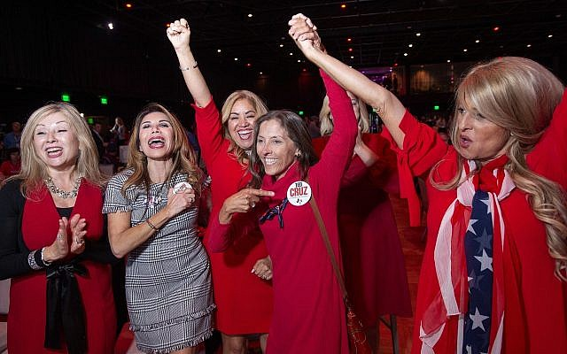 Members of the Trumpettes celebrate as incumbent US Sen. Ted Cruz, R-Texas, is announced as the winner over Democratic challenger Rep. Beto O'Rourke in a tightly contested race at the Dallas County Republican Party election night watch party on Tuesday, Nov. 6, 2018 at The Statler Hotel in Dallas. (AP Photo/Jeffrey McWhorter)
