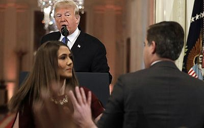 President Donald Trump looks on as a White House aide takes away a microphone from CNN journalist Jim Acosta during a news conference in the East Room of the White House, Wednesday, Nov. 7, 2018, in Washington. (AP Photo/Evan Vucci)