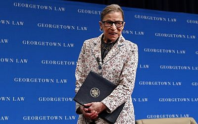 In this photo from September 26, 2018, US Supreme Court Justice Ruth Bader Ginsburg leaves the stage after speaking to first-year students at Georgetown Law in Washington. (AP Photo/Jacquelyn Martin, File)