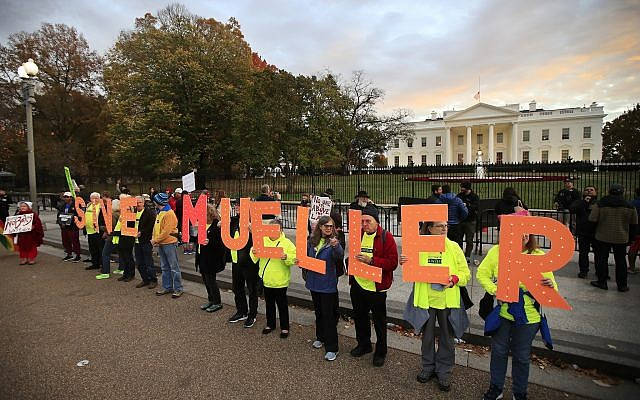 "Protesters gather in front of the White House in Washington, Thursday, November 8, 2018, as part of a nationwide ""Protect Mueller"" campaign demanding that acting US Attorney General Matthew Whitaker recuse himself from overseeing the ongoing special counsel investigation. (AP Photo/Manuel Balce Ceneta)"