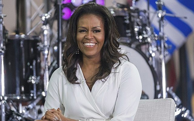 """In this October 11, 2018, file photo, Michelle Obama participates in the International Day of the Girl on NBC's """"Today"""" show in New York. (Charles Sykes/Invision/AP)"""