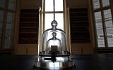 In this photo taken Wednesday, Oct. 17, 2018., a replica of the International Prototype Kilogram is pictured at the International Bureau of Weights and Measures, in Sevres, near Paris (AP Photo/Christophe Ena)