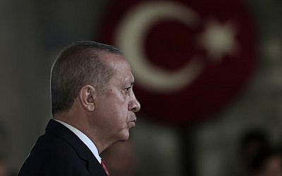 Turkey's President Recep Tayyip Erdogan attends a wreath-laying ceremony at the mausoleum of the nation's founding father Mustafa Kemal Ataturk, during a ceremony to mark the 80th anniversary of his death, in Ankara, Turkey, Saturday, Nov. 10, 2018. (AP/Burhan Ozbilici)