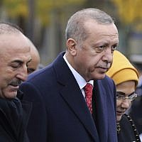 Turkish President Recep Tayyip Erdogan, right, and Turkish Foreign Minister Mevlut Cavusoglu leave the Arc de Triomphe after attending a ceremony as part of the commemorations marking the 100th anniversary of the 11 November 1918 armistice, ending World War I, November 11, 2018. (Ludovic Marin/Pool Photo via AP)