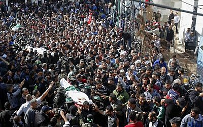 Palestinian mourners carry the bodies of two of the seven Hamas jihadists who were killed in an Israeli raid, during their funerals in Khan Younis, southern Gaza Strip, November 12, 2018. (AP Photo/Adel Hana)