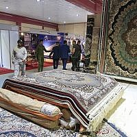 In this Saturday, November 10, 2018 photo, visitors tour the Iranian wing of the Baghdad International Fair, in Baghdad, Iraq. (AP Photo/Karim Kadim)