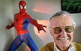 Stan Lee, creator of comic-book franchises such as 'Spider-Man,' 'The Incredible Hulk' and 'X-Men,' smiles during a photo session in his office in Santa Monica, California, April 16, 2002.  (Reed Saxon/AP)