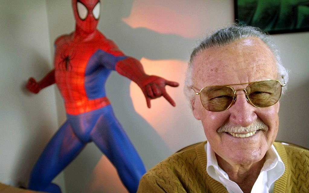 In this April 16, 2002, file photo, Stan Lee, creator of comic-book franchises such as 'Spider-Man,' 'The Incredible Hulk' and 'X-Men,' smiles during a photo session in his office in Santa Monica, California. (AP Photo/Reed Saxon, File)