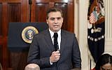 In this November 7, 2018, file photo, CNN journalist Jim Acosta speaks to the camera before a news conference with US President Donald Trump in the East Room of the White House in Washington. (AP Photo/Evan Vucci, File)