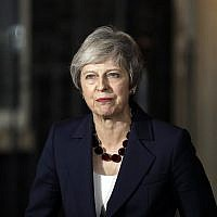 Britain's Prime Minister Theresa May delivers a speech outside 10 Downing Street in London on November 14, 2018. (AP Photo/Matt Dunham)