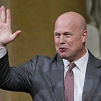 Acting Attorney General Matthew Whitaker gestures, after speaking at the Department of Justice's Annual Veterans Appreciation Day Ceremony, November 15, 2018, at the Justice Department in Washington, DC. (AP Photo/ Pablo Martinez Monsivais)