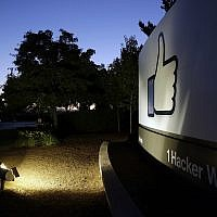 "The Facebook ""like"" symbol is illuminated on a sign outside the company's headquarters in Menlo Park, California, June 7, 2013. (AP Photo/Marcio Jose Sanchez, File)"