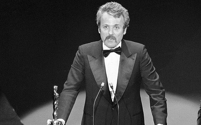In this March 28, 1977 file photo, William Goldman accepts his Oscar at the Academy Awards in Los Angeles, for best screenplay from other medium for 'All The President's Men.' Goldman, the Oscar-winning screenplay writer of 'Butch Cassidy and the Sundance Kid' and 'All the President's Men,' died, Friday, Nov. 16, 2018. He was 87. (AP Photo, File)