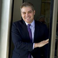 "CNN's Jim Acosta walks out of the US District Courthouse with a smile, Friday, Nov. 16, 2018, in Washington. US District Court Judge Timothy Kelly ordered the White House to immediately return Acosta's credentials. He found that Acosta was ""irreparably harmed"" and dismissed the government's argument that CNN could send another reporter in Acosta's place to cover the White House.  (AP Photo/Jose Luis Magana)"