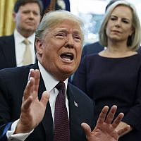 US President Donald Trump answers a reporters question about the investigation of special counsel Robert Mueller during a signing ceremony of the 'Cybersecurity and Infrastructure Security Agency Act,' in the Oval Office of the White House, Friday, Nov. 16, 2018, in Washington. (AP Photo/Evan Vucci)