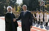 Iraqi President Barham Salih, right, and his Iranian counterpart Hassan Rouhani shake hands during an official welcome ceremony for Salih at the Saadabad Palace in Tehran, Iran, Saturday, November 17, 2018.  (Iranian Presidency Office via AP)
