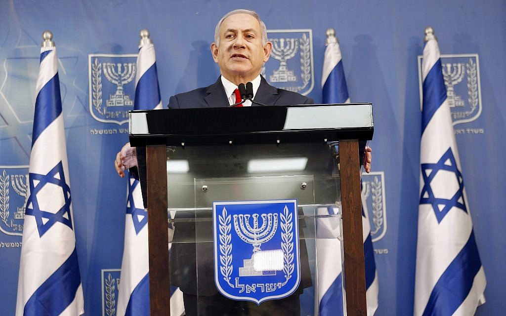 Israeli Prime Minister Benjamin Netanyahu delivers a statement in Tel Aviv, Israel, Sunday, Nov. 18, 2018. Netanyahu says he will take over temporarily as defense minister as early elections loom. (AP Photo/Ariel Schalit)