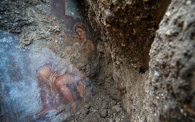 The fresco ''Leda e il cigno'' (Leda and the swan) discovered last Friday in the Regio V archeological area in Pompeii, near Naples, Italy, is seen Nov. 19, 2018 (Cesare Abbate/ANSA via AP)