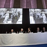From left to right, Commissioner for Education and Academia of the World Jewish Congress Jean de Gunzburg, Governing Board Chair of the World Jewish Congress David de Rothschild, UNESCO'S Director-General Audrey Azoulay, World Jewish Congress President Ronald S. Lauder and CEO and Vice President of the World Jewish Congress Robert Singer sit under two giant screen during the presentation of the website to counter Holocaust denial and anti-Semitism at the UNESCO headquartered in Paris, France, November 19, 2018. (AP Photo/Michel Euler)