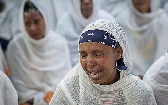 Members of Ethiopia's Jewish community protest the Israeli government's decision not to allow all of them to emigrate, at the synagogue in Addis Ababa, Ethiopia, on November 19, 2018. (AP Photo/Mulugeta Ayene)