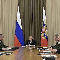 Russian President Vladimir Putin, background center, speaks during a meeting with top military officers in the Bocharov Ruchei residence in the Black Sea resort of Sochi, Russia on November 19, 2018. (Alexei Nikolsky, Sputnik, Kremlin Pool Photo via AP)