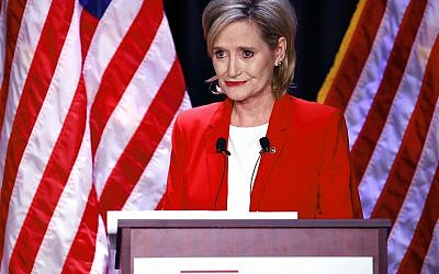 Appointed US Sen. Cindy Hyde-Smith, R-Miss., answers a question during a televised Mississippi US Senate debate with Democrat Mike Espy in Jackson, Miss., Tuesday, Nov. 20, 2018. (AP Photo/Rogelio V. Solis, Pool)