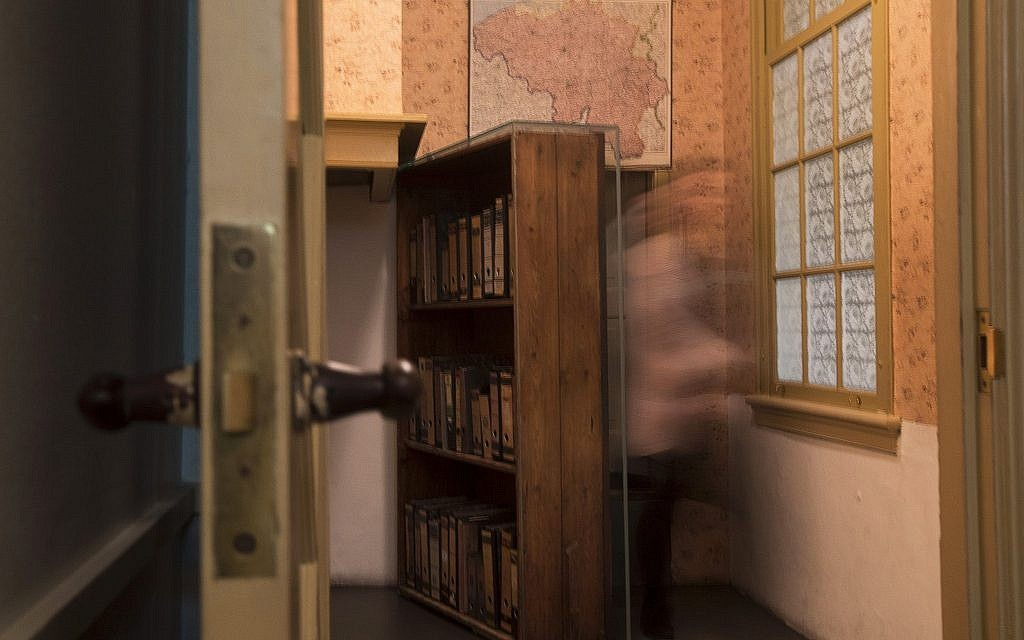A museum employee emerges from the secret annex at the renovated Anne Frank House Museum in Amsterdam, Netherlands, Wednesday, Nov. 21, 2018. (AP Photo/Peter Dejong)