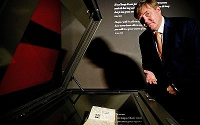 Dutch King Willem-Alexander looks at Anne Frank's diary displayed in the new Diary Room at the renovated Anne Frank House Museum in Amsterdam, Netherlands, Thursday, Nov. 22, 2018.(Patrick van Katwijk, pool photo via AP)
