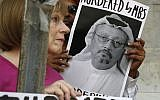 People hold signs during a protest at the Embassy of Saudi Arabia about the disappearance of Saudi journalist Jamal Khashoggi, in Washington, October 10, 2018. (AP Photo/Jacquelyn Martin, File)