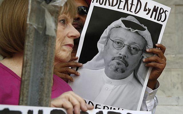 People hold signs during a protest at the Embassy of Saudi Arabia in the United States about the disappearance of Saudi journalist Jamal Khashoggi, in Washington, October 10, 2018. (AP Photo/Jacquelyn Martin, File)