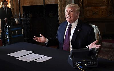 US President Donald Trump speaks to reporters following his teleconference with troops from his Mar-a-Lago estate in Palm Beach, Florida, November 22, 2018. (AP Photo/Susan Walsh)
