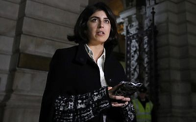Daniela Tejada, the wife of British academic Matthew Hedges, who is sentenced to life in prison for alleged espionage in the United Arab Emirates, reads a statement for the media as she leaves the Foreign Office after a meeting with Britain's Foreign Secretary Jeremy Hunt, in London, November 22, 2018 (AP Photo/Kirsty Wigglesworth)