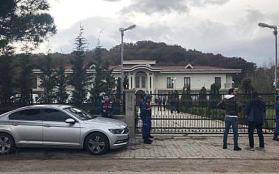 Paramilitary police officers stand at the entrance to a private villa in Yalova, Turkey, November 26, 2018. (DHA via AP)