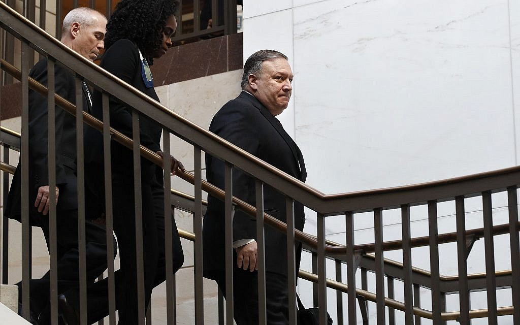 US Secretary of State Mike Pompeo, right, arrives for a closed door meeting with Senators about Saudi Arabia, November 28, 2018, on Capitol Hill in Washington. (AP Photo/Jacquelyn Martin)