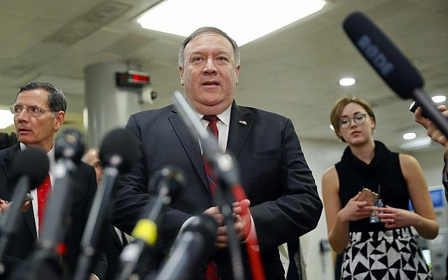 US Secretary of State Mike Pompeo walks up to the microphones to speak to members of the media, after leaving a closed door meeting about Saudi Arabia, November 28, 2018, on Capitol Hill in Washington, DC. (AP Photo/Pablo Martinez Monsivais)