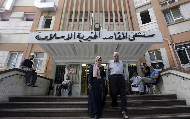 Palestinians leave the Makassed hospital in East Jerusalem, September 9, 2018. (Mahmoud Illean/AP)