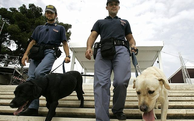 Illustrative: Two Italian explosive police experts walk their sniffer dogs on the stairs of the sanctuary of Madonna di Bonaria in Cagliari, Sardinia, Italy, Saturday, Sept. 6, 2008. (AP/Pier Paolo Cito)