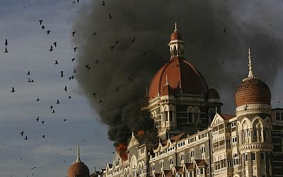 Pigeons fly as the Taj Hotel burns in Mumbai, India, Thursday, November 27, 2008.  (AP/Gautam Singh)